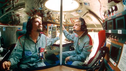 Branson and Per Lindstrand sit in a capsule as they prepare to fly in a hot-air balloon in 1991. In 1987, Branson and Lindstrand became the first people to cross the Atlantic Ocean in a hot-air balloon.