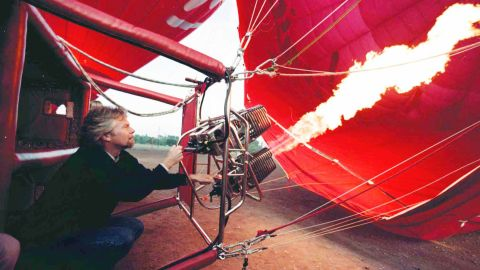 Branson fires up a Virgin balloon outside the city walls of Marrakesh, Morocco, in 1996.