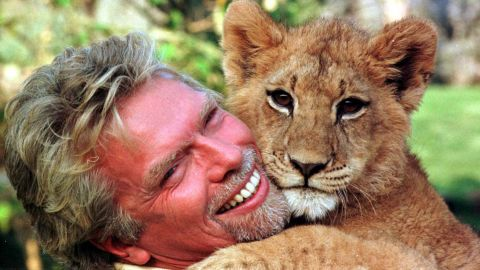 Branson cuddles with a young lion cub at South Africa's Sun City resort in 1996.
