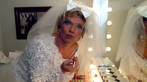 Branson applies makeup before the launch of his Virgin Brides venture in 1996. The business combined weddings and honeymoons in a one-stop shop.