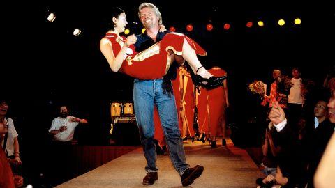 In 1999, Branson celebrates Virgin Atlantic's inaugural flight to Shanghai, China.