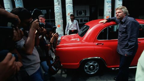 Branson poses for photos in India after launching a direct flight from London to New Delhi in 2000.