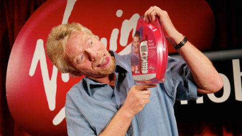 Branson launches Virgin Mobile USA, a cellular phone service, at New York's Times Square in 2002.