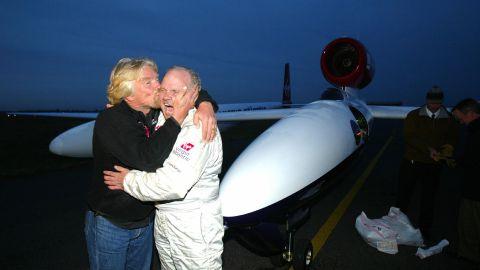 Branson kisses Steve Fossett after Fossett flew the Virgin Atlantic GlobalFlyer for 25,766 miles in 2006. It was the longest nonstop flight in history.