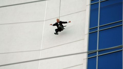 Branson jumps off the roof of the Palms hotel in Las Vegas as part of a publicity stunt for his Virgin America airline in 2007.