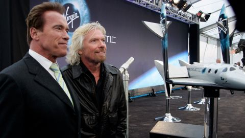 Branson and California Gov. Arnold Schwarzenegger address the media as Virgin Galactic unveiled a commercial spacecraft designed to send passengers into orbit for $200,000 a ticket.
