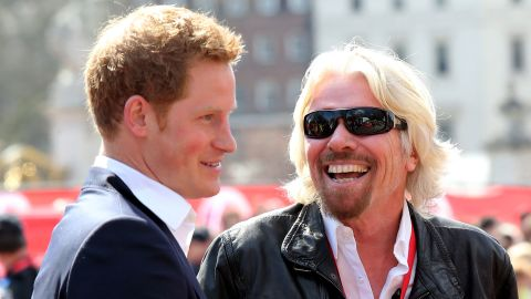 Branson chats with Britain's Prince Harry at the finish of the London Marathon in 2013. Virgin has been sponsoring the event for years.