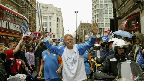 Branson runs with the Olympic torch in London in 2004, ahead of the Olympic Games that year in Athens, Greece.