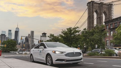 A self-driving vehicle from Mobileye's autonomous test fleet sits parked in front of the Manhattan Bridge in June 2021. Mobileye tests its technology in complex urban areas in preparation for future driverless services. (Credit: Mobileye, an Intel Company)