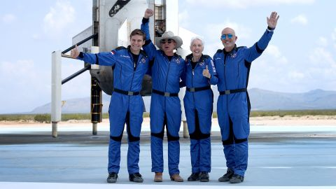 """From left, Oliver Daemen, Bezos, Wally Funk and Bezos' brother Jeff pose for a picture after <a href=""""http://www.cnn.com/2021/07/20/us/gallery/jeff-bezos-spaceflight/index.html"""" target=""""_blank"""">flying into space</a> in July 2021. The trip marked the first-ever crewed flight of Blue Origin's suborbital space tourism rocket, New Shepard."""