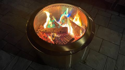 A Solo Stove Yukon burning color packs.