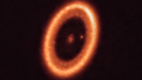 This image, taken with the Atacama Large Millimeter/submillimeter Array in Chile, shows the PDS 70 system 400 light-years away. This planetary system is still forming and still in the process of being formed. One of the planets in the system has a moon-forming disk around it.