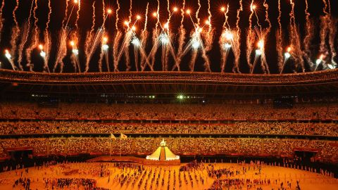 TOKYO, JAPAN - JULY 23: General view inside the stadium as fireworks go off while Naomi Osaka of Team Japan lights the Olympic cauldron with the Olympic torch during the Opening Ceremony of the Tokyo 2020 Olympic Games at Olympic Stadium on July 23, 2021 in Tokyo, Japan. (Photo by Laurence Griffiths/Getty Images)