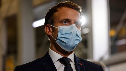 France's President Emmanuel Macron speaks with doctors and nurses working at the French Polynesia Hospital Centre in Papeete following his arrival for a visit to Tahiti in French Polynesia on July 24, 2021.