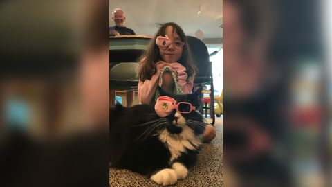 Marin, a patient with amblyopia, and Truffles wear matching eye patches.
