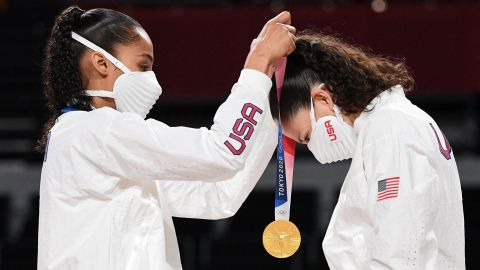 Team USA's Skylar Diggins (L) puts a gold medal on teammate Sue Bird during the medal ceremony for the women's basketball competition of the Tokyo 2020 Olympic Games on August 8.