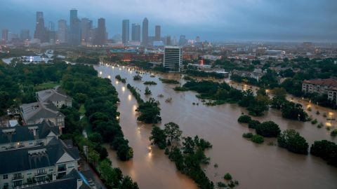 Downtown Houston is seen behind the flooded Buffalo Bayou a few days after Hurricane Harvey came ashore in August 2017. The Category 4 storm caused historic flooding. It set a record for the most rainfall from a tropical cyclone in the continental United States, with 51 inches of rain recorded in areas of Texas. An estimated 27 trillion gallons of water fell over Texas and Louisiana during a six-day period.