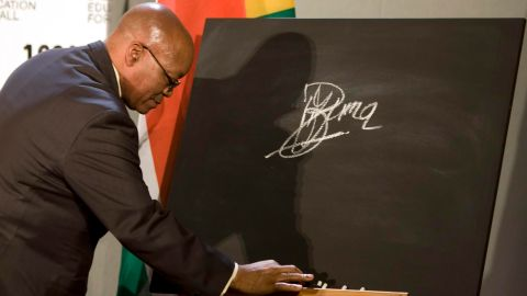 Zuma signs a blackboard in October 2009, pledging South Africa's support for a global campaign to ensure education for all the world's children.