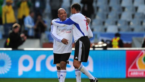 Zuma, left, and Sky Sports commentator Chris Kamara play a charity soccer match in Cape Town, South Africa, in July 2010.
