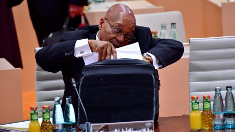"""Zuma talks on his cell phone during a G20 session in Hamburg, Germany, in July 2017. A month later, <a href=""""http://www.cnn.com/2017/08/08/africa/zuma-south-africa-vote/index.html"""" target=""""_blank"""">he survived an ouster attempt</a> in his country's National Assembly. A motion of no-confidence was defeated by 198 votes to 177."""