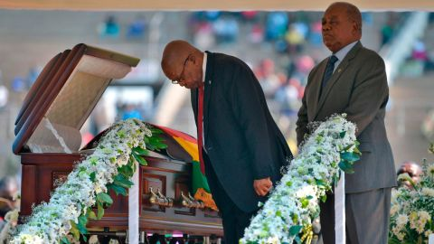 Zuma bows toward the casket of the late Zimbabwean President Robert Mugabe during a farewell ceremony in Harare, Zimbabwe, in September 2019.