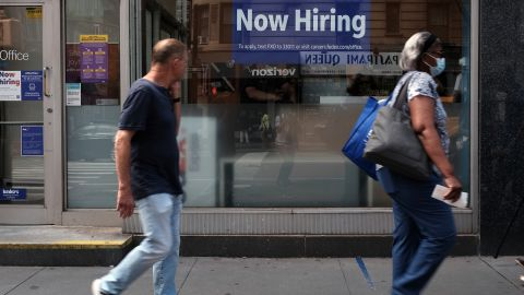 A hiring sign is displayed in a store window in Manhattan on August 19, 2021 in New York City. Despite continued concerns about the Delta variant of the Covid virus, the United States economy continues to grow with the leading economic index jumping 0.9% last month. (Photo by Spencer Platt/Getty Images)