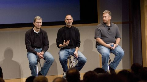 From left, then-Apple COO Tim Cook, Apple CEO Steve Jobs and Phil Schiller, executive vice president for product marketing, answer questions after Jobs introduced new versions of the iMac and the iLife software applications at Apple's headquarters in Cupertino, California, on August 7, 2007.