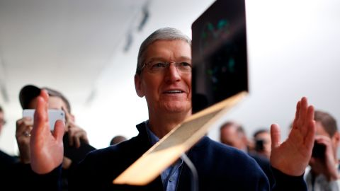 Cook stands in front of a MacBook display after an Apple special event at the Yerba Buena Center for the Arts in San Francisco on March 9, 2015.