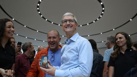 Cook and Apple chief design officer Jonathan Ive look at the new Apple iPhone X during an Apple special event at the Steve Jobs Theatre on September 12, 2017.