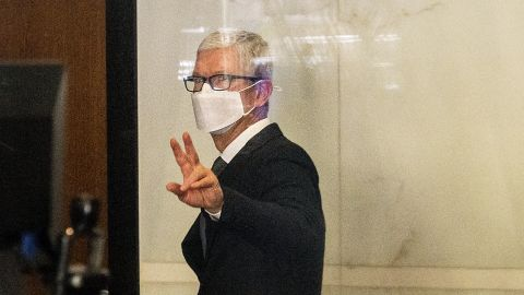 Cook leaves the Ronald V. Dellums Federal Building in Oakland, California, on May 21, 2021, after testifying in a federal lawsuit brought by Epic Games. Epic, the maker of the video game Fortnite, charges that Apple has transformed its App Store into an illegal monopoly.