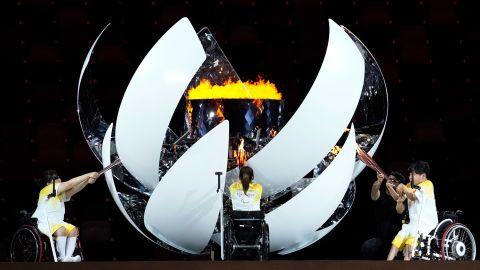 Athletes light the Paralympic cauldron during the opening ceremony for the 2020 Paralympics at the National Stadium in Tokyo, Tuesday, Aug. 24, 2021. (AP Photo/Shuji Kajiyama)