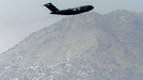 An US Air Force aircraft takes off from the airport in Kabul on August 30, 2021. - Rockets were fired at Kabul's airport on August 30 where US troops were racing to complete their withdrawal from Afghanistan and evacuate allies under the threat of Islamic State group attacks. (Photo by Aamir QURESHI / AFP) (Photo by AAMIR QURESHI/AFP via Getty Images)