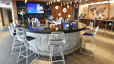 Grab a drink from the bar at the Amex Centurion Suite at the US Open.