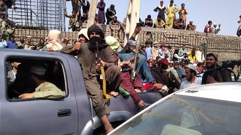 TOPSHOT - Taliban fighters sit on a vehicle along the street in Jalalabad province on August 15, 2021. (Photo by - / AFP) (Photo by -/AFP via Getty Images)