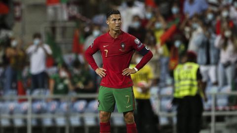 TOPSHOT - Portugal's forward Cristiano Ronaldo reacts after the FIFA World Cup Qatar 2022 European qualifying round group A football match between Portugal and Republic of Ireland at the Algarve stadium in Loule, near Faro, southern Portugal, on September 1, 2021. (Photo by CARLOS COSTA/AFP via Getty Images)