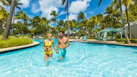 Use Amex's transfer bonus to redeem enough Hilton points for five nights at the Hilton Aruba Caribbean Resort and Casino hotel.