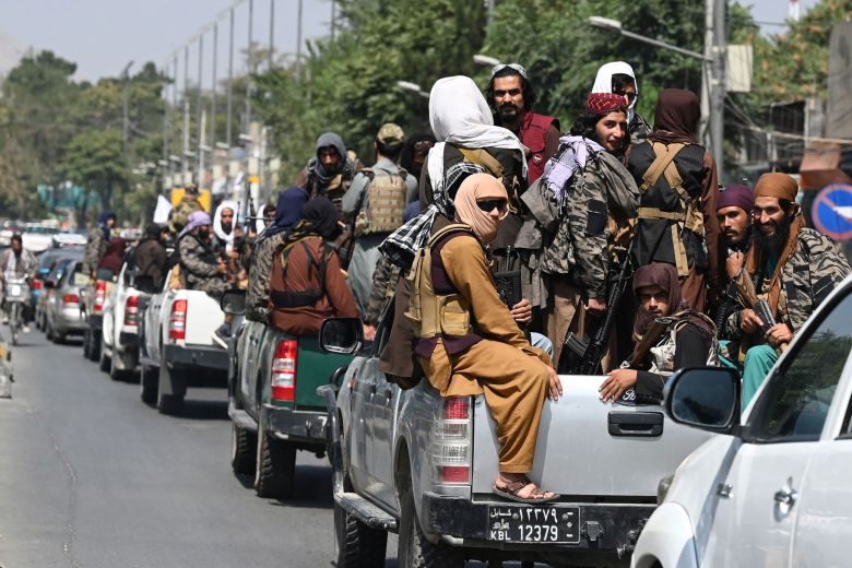 A convoy of Taliban fighters patrol along a street in Kabul on September 2, 2021. (Photo by Aamir QURESHI / AFP) (Photo by AAMIR QURESHI/AFP via Getty Images)