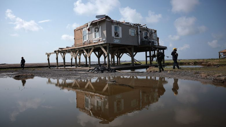 GRAND ISLE, LOUISIANA - SEPTEMBER 02: A search and rescue team checks homes destroyed in the wake of Hurricane Ida September 2, 2021 in Grand Isle, Louisiana. Ida made landfall August 29 as a Category 4 storm near Grand Isle, southwest of New Orleans, causing widespread power outages, flooding and massive damage.  (Photo by Win McNamee/Getty Images)