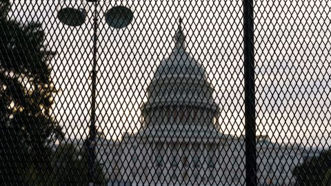 Security fencing has been reinstalled around the Capitol in Washington, Thursday, Sept. 16, 2021, ahead of a planned Sept. 18 rally by far-right supporters of former President Donald Trump who are demanding the release of rioters arrested in connection with the 6 January insurrection. (AP Photo/J. Scott Applewhite)