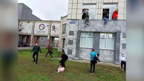 6655245 20.09.2021 Students jump from windows of Perm State National Research University during a shooting, in Perm, Russia. According to preliminary information Some people were killed and others injured during a shooting at the Perm State National Research University. Alexey Romanov/Sputnik  via AP