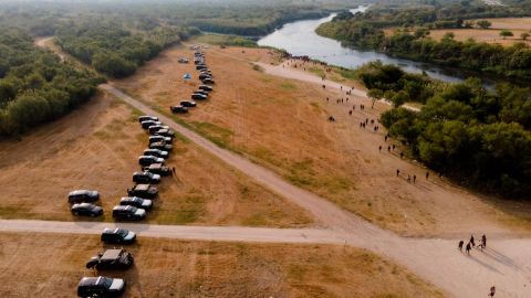 Official vehicles line up along the bank of the Rio Grande near an encampment of migrants, many from Haiti, near the Del Rio International Bridge, on Sept. 21, 2021, in Del Rio, Texas. The U.S. is flying Haitians camped in a Texas border town back to their homeland and blocking others from crossing the border from Mexico
