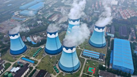 Steam billows out of the cooling towers at a coal-fired power station in Nanjing in east China's Jiangsu province
