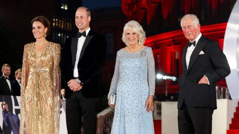 """Britain's Prince William, Duke of Cambridge (2L) and Britain's Catherine, Duchess of Cambridge (L) stand with Britain's Prince Charles, Prince of Wales (R) and Britain's Camilla, Duchess of Cornwall as they arrive for the World Premiere of the James Bond 007 film """"No Time to Die"""" at the Royal Albert Hall in west London on September 28, 2021. - Celebrities and royals walk the red carpet in central London on Tuesday for the star-studded but much-delayed world premiere of the latest James Bond film, """"No Time To Die"""". (Photo by Chris Jackson / POOL / AFP) (Photo by CHRIS JACKSON/POOL/AFP via Getty Images)"""