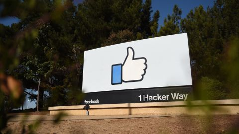 """The Facebook """"like"""" sign is seen at Facebook's corporate headquarters campus in Menlo Park, California, on October 23, 2019."""