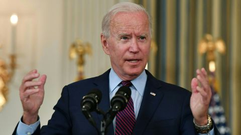 """US President Joe Biden gestures as he delivers remarks on the debt ceiling from the State Dining Room of the White House on October 4, 2021 in Washington, DC. - President Joe Biden on Monday called Republican opponents """"reckless and dangerous"""" for refusing to join Democrats in raising the US debt limit, putting the world's biggest country at risk of imminent default."""