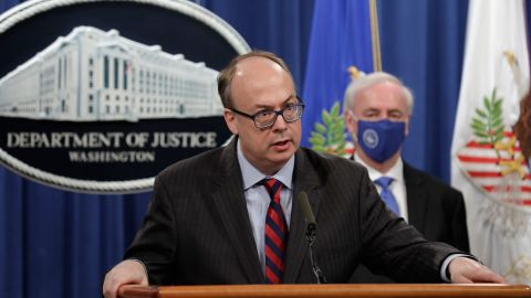 Acting Assistant U.S. Attorney General Jeffrey Clark speaks as he stands next to Deputy Attorney General Jeffrey A. Rosen during a news conference to announce the results of the global resolution of criminal and civil investigations with an opioid manufacturer at the Justice Department in Washington, Wednesday, Oct. 21, 2020. (Yuri Gripas/Pool via AP)