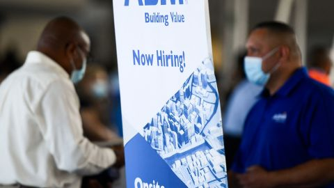 ABM Industries Inc. hiring announcement is posted as people attend a job fair for employment with SoFi Stadium and Los Angeles International Airport employers, at SoFi Stadium on September 9, 2021, in Inglewood, California.