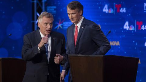 Virginia Democratic gubernatorial candidate and former Gov. Terry McAuliffe, left, and Republican challenger, Glenn Youngkin, walk off the stage after a debate at Northern Virginia Community College, in Alexandria, Va., on, Sept. 28, 2021.