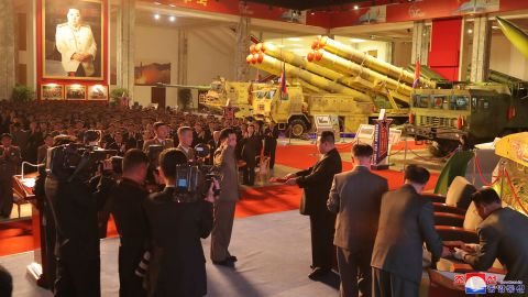 In this photo provided by the North Korean government, North Korean leader Kim Jong Un, fourth from right, visits an exhibition of weapons systems in Pyon