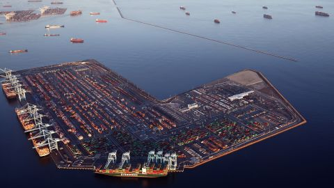 Container ships (Top R) are anchored by the ports of Long Beach and Los Angeles as they wait to offload on September 20, 2021 near Los Angeles, California.